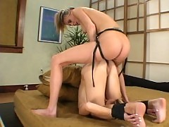 Kelly takes it in the ass with a strap-on from her hot roommate